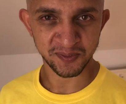 Lulzim B. mit Glatze, kurzem Bart sowie Oberlippenbart und im gelbem T-Shirt